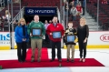 (Pictured Left to Right) Alexandra Dousmanis-Curtis, BMO Harris Bank, Volunteer - Tom Cotter, St Patrick High School, Coach - Willis Griffin, Naperville Central JV, Player - Cole Walsh, Joliet Jaguars, Annie Camins, Chicago Blackhawks Youth Hockey Director