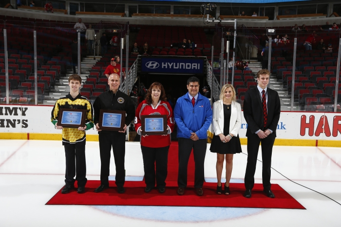 Pictured Left to Right: Player- Brendon Meyers, Hornets Sled Hockey, Coach- Michael Svac, Chicago Blackhawks Special Hockey, Volunteer- Susan Foster, Plainfield High School, BMO Representative, Lucino Sotelo, Annie Camins, Youth Hockey Director, Chicago Blackhawks, Spencer Montgomery, Youth Hockey Coordinator, Chicago Blackhawks