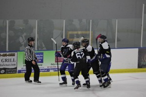 Team Captain, Trevor Kurtzhals, and his teammates celebrating a recent goal