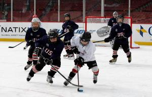 BOSTON, Jan. 2, 2012 -- USA Hockey youth teams play on the ice at Fenway Park during Sun Life Frozen Fenway. (Brita Meng Outzen/Boston Red Sox)