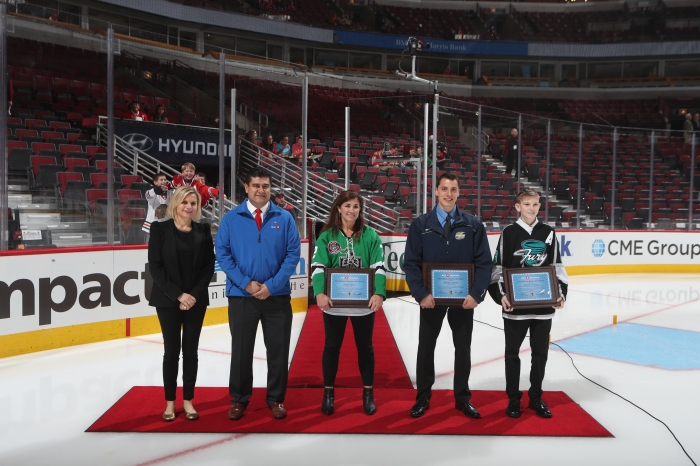 Pictured left to right: Annie Camins - Chicago Blackhawks, Senior Director, Fan Development, Lucino Sotelo - Chief Marketing Officer, US P&C, BMO Harris Bank, Becky Malone - Volunteer of the Month, Christian Esposito - Coach of the Month, Patrick McGown - Player of the Month