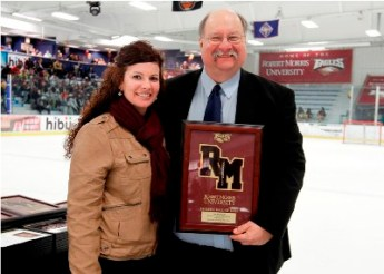 RMU-IL Athletic Director Megan Smith Eggert presenting Tom Wendlandt with a plaque commemorating his induction into the RMU-IL Athletics Hall-of-Fame in 2014.