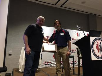 Chicago Mission's Gino Cavallini being presented with the USA Hockey Female Honors Award by AHAI President, John Dunne