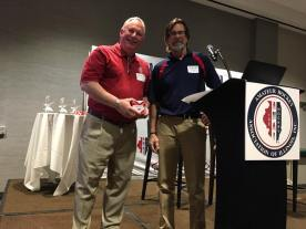 Dough Becht receiving the AHAI Service Award from AHAI President, John Dunne