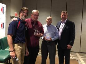 Jim Neville and Rich Blight receiving the AHAI Lifetime Achievement Award from AHAI President, John Dunne and USA Hockey President, Jim Smith