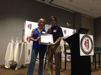 Melissa Rotunno being presented with the USA Hockey New Leader Award by AHAI President, John Dunne