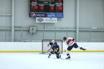 Forward #77 Ricky Jones scores in the October 28th win against Lake Forest Gold in the Madison WI tournament.