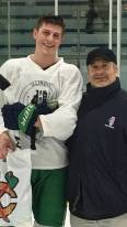 John C. Robinson (New Trier Green) - recipient of the 2018 Terry J. Stasica MVP Award with Jack Weinberg, AHAI High School Chairman.