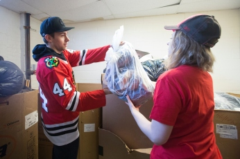 CHICAGO, IL - March 13: Chicago Blackhawks defenseman Jan Rutta volunteers with the winning youth group of the 2017-18 Chicago Blackhawks ServICE Crew at Cornerstone Community Outreach on March 13, 2018.